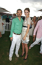MATTHEW WILLIAMSON and actress MISCHA BARTON at the Cartier International polo at Guards Polo Club, Windsor Great Park, on 30th July 2006.<br /><br />NON EXCLUSIVE - WORLD RIGHTS