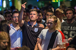 © Licensed to London News Pictures . 15/06/2014 .  Manchester , UK . England fans at 1-2 down to Italy . Football fans watch the England vs Italy World Cup tie at Walkabout in Manchester City Centre early this morning (Sunday 15th June 2014) as England play Italy in their first match of the 2014 World Cup , in Brazil . Photo credit : Joel Goodman/LNP
