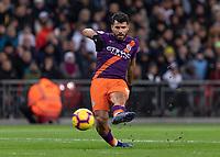 Football - 2018 / 2019 Premier League - Tottenham Hotspur vs. Manchester City<br /> <br /> Sergio Aguero (Manchester City) curls his shot at the Tottenham goal at Wembley Stadium.<br /> <br /> COLORSPORT/DANIEL BEARHAM