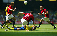 Photograph: Scott Heavey.<br />FA Community Shield fomr the Millenium Stadium in Cardiff. 10/08/2003.<br />Thierry Henry lays injured after a tackle by Roy Keane.