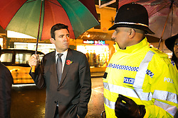 © Licensed to London News Pictures. 03/11/2015. Alum Rock, Birmingham, UK. Shadow Home Secretary ANDY BURNHAM visiting Alum Rock in Birmingham to launch the Labour Policy on Policing. Pictured, ANDY BURNHAM, left, talking to Sgt IFTI ALI on the Alum Rock Road. Photo credit : Dave Warren/LNP