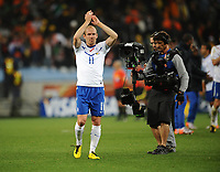 Football - 2010 FIFA World Cup - Netherlands vs. Cameroon<br /> Arjen Robben of the Netherlands celebrates their win and qualification to the second round top of their group at the final whistle at Green Point Stadium, Cape Town