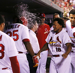 May 31, 2017 - St Louis, MO, USA - The St. Louis Cardinals' Dexter Fowler is splashed by pitcher Carlos Martinez in the dugout after he hit a solo home run in the eighth inning against the Los Angeles Dodgers on Wednesday, May 31, 2017, at Busch Stadium in St. Louis. The Cards won, 2-1. (Credit Image: © Chris Lee/TNS via ZUMA Wire)