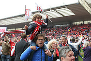 Middlesbrough fans celebrating promotion during the Sky Bet Championship match between Middlesbrough and Brighton and Hove Albion at the Riverside Stadium, Middlesbrough, England on 7 May 2016. Photo by Simon Davies.