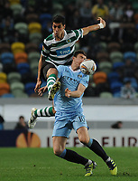 20120308: LISBON, PORTUGAL – UEFA Europa League 2011/2012 - 1st Leg: Sporting CP vs Man. City.<br /> In photo: Xandao and Edin Dzeko<br /> PHOTO: Alvaro Isidoro/CITYFILES