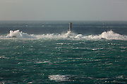"""Storm waves crash onto the reef just 1 mile West of Land's End, the most South Westerly point of Cornwall and indeed the British Isles. This large and treacherous Longships reef is marked by the 35meter high """"Longships Lighthouse"""" (1795) who's light reaches 15 nautical miles."""