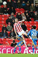 Peter Crouch for Stoke City climbs up 5 Matt Sadler for Shrewsbury Town to win the header during the The FA Cup 3rd round replay match between Stoke City and Shrewsbury Town at the Bet365 Stadium, Stoke-on-Trent, England on 15 January 2019.