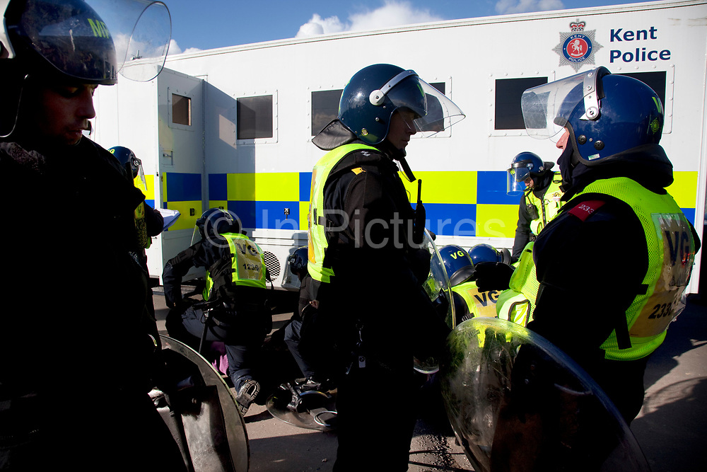 Riot police deal with a protester having been removed from the scaffolding structure. She seemed shaky and distressed. The travellers were certain protesters were being tasered prior to arrest. Protesters who barricaded themselves above the entrance to the Dale Farm travellers' site have been removed by police as bailiffs prepare to move in. Essex Police cleared the scaffolding structure so it could be dismantled and machinery driven in by bailiffs to evict the travellers. On Wednesday night Essex Police said that over the course of the day 23 people had been arrested. Clearance of Dale Farm prior to eviction. Riot police and bailiffs were present on 19th October 2011, as a scaffolding gantry was cleared of protesters so the site could be cleared. Dale Farm is part of a Romany Gypsy and Irish Traveller site on Oak Lane in Crays Hill, Essex, United Kingdom. Dale Farm housed over 1,000 people, the largest Traveller concentration in the UK. The whole of the site is owned by residents and is located within the Green Belt. It is in two parts: in one, residents constructed buildings with planning permission to do so; in the other, residents were refused planning permission due to the green belt policy, and built on the site anyway.