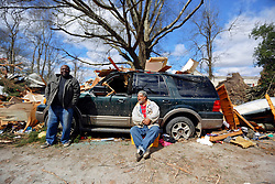 24 February 2016. Water tower Street, Convent, Louisiana.<br /> Devastation following a deadly EF2 tornado touchdown. 2 confirmed dead. <br /> Clarence Walters (center) sits beside the remains of his business partners destroyed trailer home and car. His friend was in the home when it was flipped over into the middle of the street.<br /> Photo©; Charlie Varley/varleypix.com