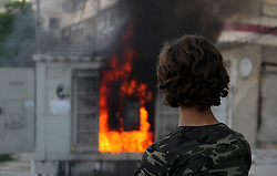 30.06.2015, Aleppo, SYR, Bürgerkrieg in Syrien, im Bild Feuerwehrleute löschen einen Brand nach einem Bomben Angriff // Syrian firefighters try to extinguish the fire in the burning houses in a reported barrel bomb attack by Syrian government forces in Bab al-Nairab distric, Syria on 2015/06/30. EXPA Pictures © 2015, PhotoCredit: EXPA/ APAimages/ Ameer al-Halbi<br /> <br /> *****ATTENTION - for AUT, GER, SUI, ITA, POL, CRO, SRB only*****