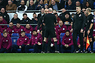 Pep Guardiola, the Manchester city manager speaks with referee Lee Mason and his assistants during the Emirates FA Cup, 4th round match, Cardiff city v Manchester City at the Cardiff City Stadium in Cardiff, South Wales on Saturday 28th January 2018.<br /> pic by Andrew Orchard, Andrew Orchard sports photography.
