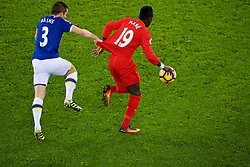 LIVERPOOL, ENGLAND - Monday, December 19, 2016: Liverpool's Sadio Mane has his shirt pulled by Everton's Leighton Baines during the FA Premier League match, the 227th Merseyside Derby, at Goodison Park. (Pic by Gavin Trafford/Propaganda)