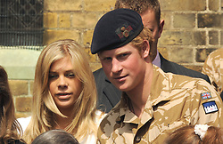 Prince Harry and girlfriend Chelsy Davy leave a service of Remembrance for those who have died in Afghanistan at the Army Garrison Church in Windsor.