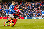 Ryan Kent of Rangers get wiped out by Greg Taylor of Kilmarnock during the Ladbrokes Scottish Premiership match between Rangers and Kilmarnock at Ibrox, Glasgow, Scotland on 16 March 2019.