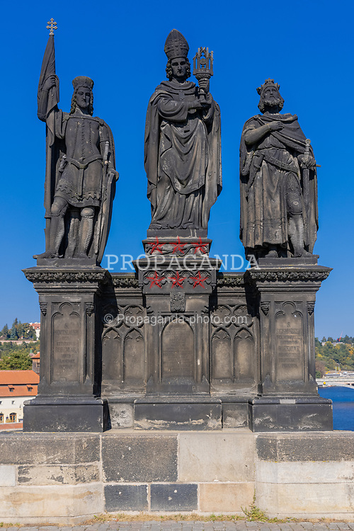 PRAGUE, CZECH REPUBLIC - Friday, October 8, 2021: Statue of Saints Norbert of Xanten, Wenceslas and Sigismund, on Charles Bridge in Prague. Is is the oldest statue on the bridge. (Pic by David Rawcliffe/Propaganda)