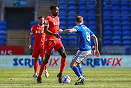 Nottingham Forest's Sammy Ameobi (11) looks to dribble past Cardiff City's Joe Ralls (8) during the EFL Sky Bet Championship match between Cardiff City and Nottingham Forest at the Cardiff City Stadium, Cardiff, Wales on 2 April 2021.