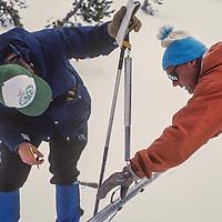 Snow surveyors for the Califonria Department of Water Resources measure the snowpack below Kearsarge Pass in  John Muir Wilderness,  Sierra Nevada, CA