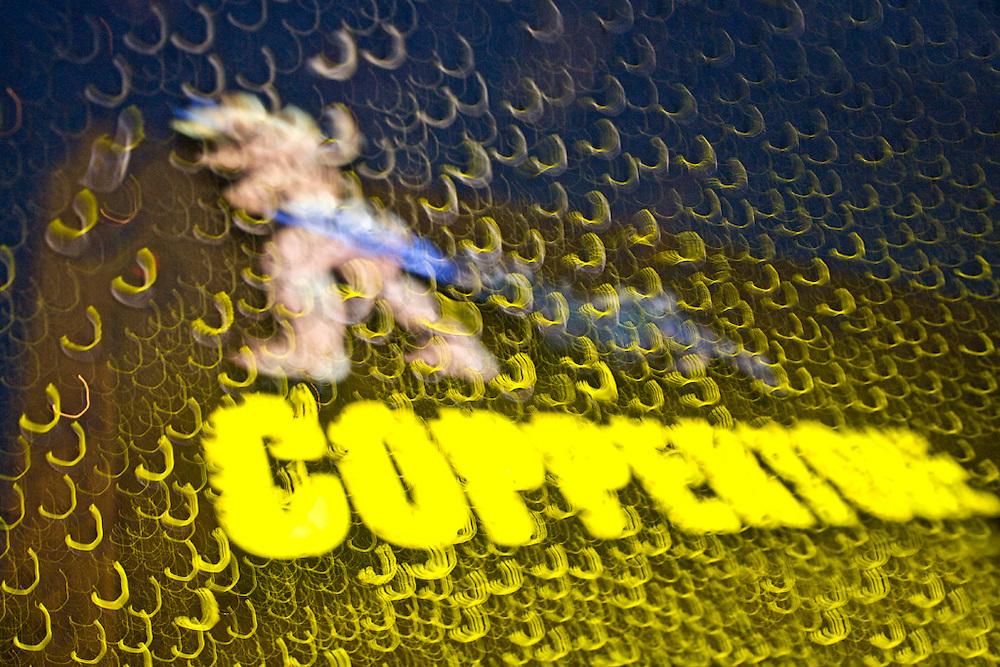 Coppertone Girl through the sunroof in the rain