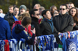 Aiyawatt Srivaddhanaprabha (centre) views floral tributes for those who lost their lives in the Leicester City helicopter crach including Leicester City Chairman Vichai Srivaddhanaprabha ahead of the Premier League match at the King Power Stadium, Leicester.