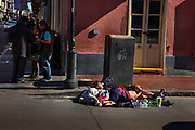 Homeless woman sleeping with dog on the street on 26th February 2020 in New Orleans, Louisiana, United States. On the streets of the French Quarter, groups of homeless people perch outside of storefronts sometimes for hours. Loitering laws have been repeatedly ruled unconstitutional, and a persons mere presence in a public space is not illegal.