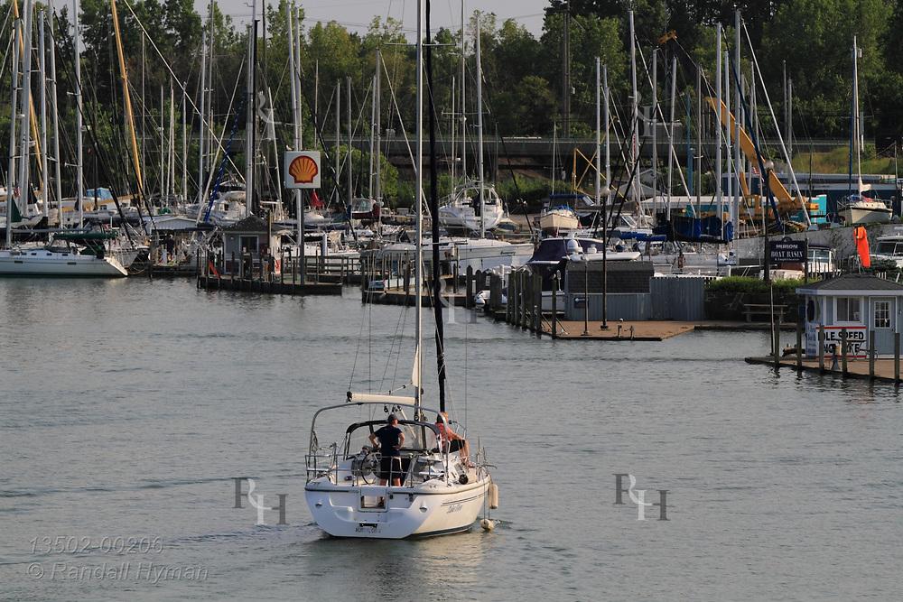 Boats enter and leave harbor at Huron Boat Basin; Lake Erie, Huron, OH.