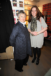 Left to right, PRISCILLA CARLUCCIO and EMMA WOODFORD at reception to raise funds for a Ugandan School Project supported by the Henry van Straubenzee Memorial Fund held at Few & Far, 242 Brompton Road, London SW3 on 11th February 2010.