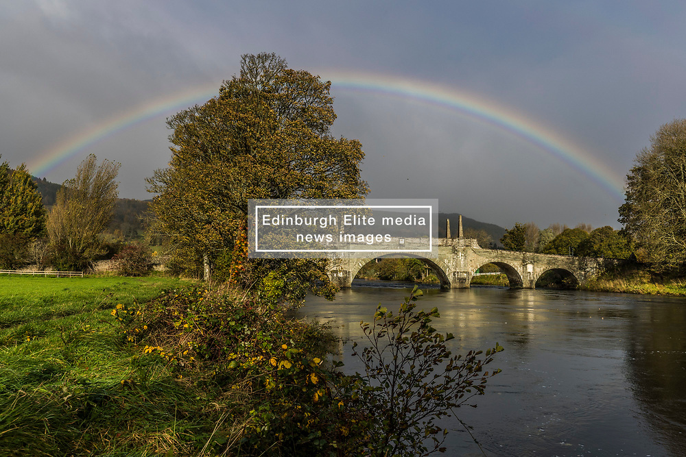 A rainbow arches over the top of the Tay Bridge in Aberfeldy. Opened in 1735 by General Wade and designed by William Adam, the bridge still carries road traffic from the Highlands int Aberfeldy.