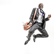 A businessman jumping high, for joy. Shot in the Hype commercial photography studio.