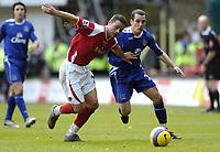Photo: Olly Greenwood.<br />Charlton Athletic v Everton. The Barclays Premiership. 25/11/2006. Charlton's Luke Young and Everton's Leon Osman