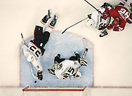 Anaheim Ducks' goaltender Jean-Sebastien Giguere watches defenseman Francois Beauchemin dive in a futile attempt to stop a shot by Tomas Holmstrom in the third period of the Ducks' 2-1 loss in Game 1 of the Western Conference Finals at Joe Louis Arena Friday May 11, 2007.