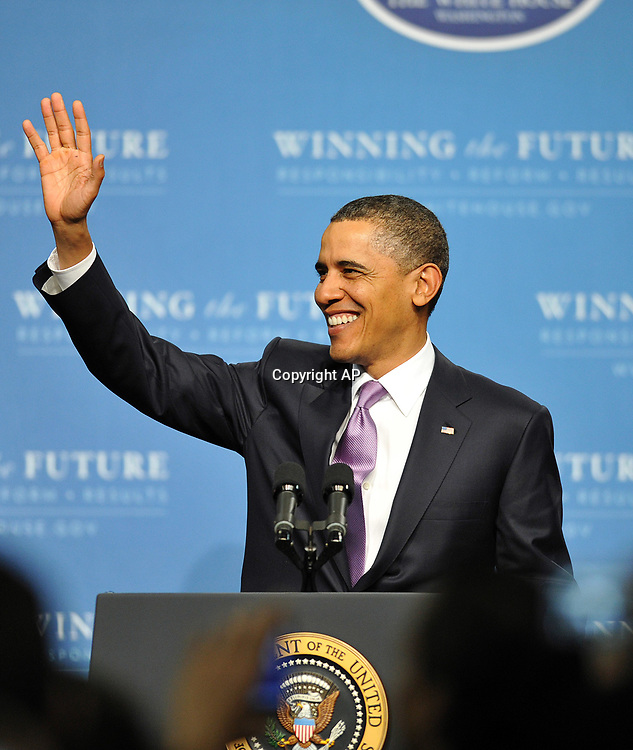 President Barack Obama, waves to as he arrives at Miami Central Senior High Friday, March. 4, 2011 in Miami Fla. (AP Photo/Steve Mitchell)