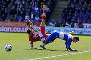 Reading's Chris Gunter (2) collides with Southampton's Jay Rodriguez. Barclays Premier league, Reading v Southampton at the Madejski stadium in Reading on Saturday 6th April 2013. pic by Andrew Orchard, Andrew Orchard sports photography,
