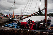 """Ciara Malone amoung the crewmembers unloading the turf from """"Capall"""" ,the oldest boat taking part in the Crinniú na mBad,Kinvara,Co Galway at the weekend. Photograph by Eamon Ward"""