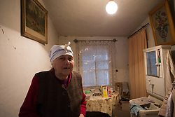 Nina Morozova, 84, lives alone in a small apartment that has been damaged by the recent fighting in her home town of Debaltsevo. She has recently received a donation of plastic sheeting from an international aid charity to cover over her broken windows.