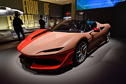"""© Licensed to London News Pictures. 14/11/2017. London, UK.  A clay model for the Ferrari J50, 2015, where half has been finished and painted.  Preview of """"Ferrari: Under the Skin"""", an exhibition at the Design Museum to mark the 70th anniversary of Ferrari.  Over GBP140m worth of Ferraris are on display from private collections including Michael Schumacher's 2000 F1 winning car.  The exhibition runs 15 November to 15 April 2018.  Photo credit: Stephen Chung/LNP"""