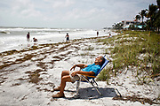 William DeShazer/Staff<br /> A man sleeps on the beach as high waves and winds from Tropical Storm Debby pass over Florida on Tuesday June 26, 2012.on Tuesday June 26, 2012.