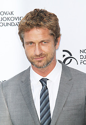 © Licensed to London News Pictures. Gerard Butler at the Novak Djokovic Foundation London gala dinner, The Roundhouse, London UK, 08 July 2013. Photo credit: Richard Goldschmidt/LNP