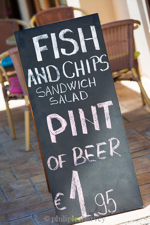 A food menu outside a local restaurant in Paphos, Cyprus.