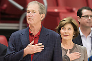 DALLAS, TX - DECEMBER 17: Former President George W. Bush and his wife Laura Bush stand during the National Anthem before tipoff between the SMU Mustangs and the Hampton Pirates on December 17, 2015 at Moody Coliseum in Dallas, Texas.  (Photo by Cooper Neill/Getty Images) *** Local Caption *** George W. Bush, Laura Bush