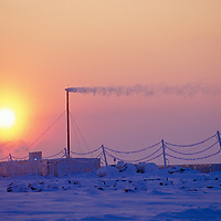 Midnight sun hovers over Golomianiyy Weather Station, Severnaya Zemlya, Russia.