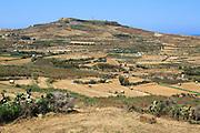 Rural landscape view from Zebbug to hilltop Ta 'Gurdan, Gordan or Gordon lighthouse, Gozo, Malta