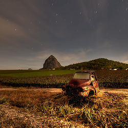 Beerwha PIneapple Fields Beerwaw Pineapple fields, Queensland By Jaydon cabe, showing an old rusty car int eh middle of a field