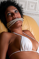 Young brunette woman very scared and bonded with ropes.