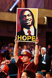 "A Washington Redskins fan holds up a sign with a picture of Robert Griffin III and the word ""HOPE"" during the first round of the NFL Draft on April 26th 2012 at Radio City Music Hall in New York, New York. (AP Photo/Brian Garfinkel)"