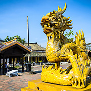 A dragon statue at the Imperial City in Hue, Vietnam. A self-enclosed and fortified palace, the complex includes the Purple Forbidden City, which was the inner sanctum of the imperial household, as well as temples, courtyards, gardens, and other buildings. Much of the Imperial City was damaged or destroyed during the Vietnam War. It is now designated as a UNESCO World Heritage site.