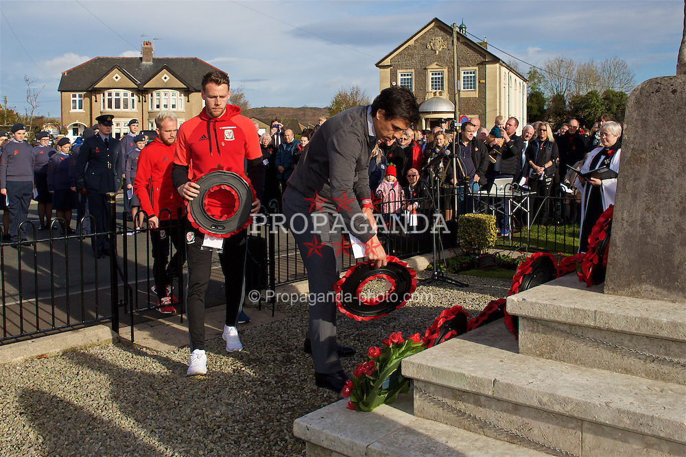 CARDIFF, WALES - Sunday, November 13, 2016: Wales' manager Chris Coleman, Chris Gunter along with Neil Taylor and Jonathan Williams lay wreaths at the Pontyclun war memorial on Remembrance Sunday to remember those that lost their lives in the two Great Wars. (Pic by David Rawcliffe/Propaganda)
