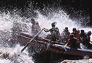 """A group of river rafters hit """"Big Drop #3"""" while running the Colorado River in Cataract Canyon, Southern Utah."""