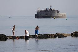 © Licensed to London News Pictures. 23/05/2015. St. Helens, UK. A family fishing for crabs at The Duver beach in St. Helens on the Isle of Wight today, Friday 23rd May 2015. Today has been warm and sunny in the South of England. Photo credit : Rob Arnold/LNP