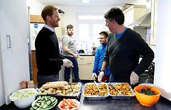 The Duke of Sussex meets staff and volunteers preparing a hot healthy lunch during a visit to Streatham Youth and Community Trust's John Corfield Centre to see a 'Fit and Fed' February half-term holiday activity programme.