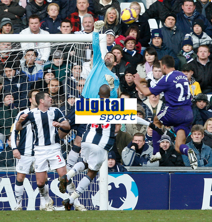Photo: Steve Bond/Richard Lane Photography. West Bromwich Albion v Newcastle United. Barclays Premiership. 07/02/2009. Keeper Scott Carson punches as Steven Taylor (R) closes in